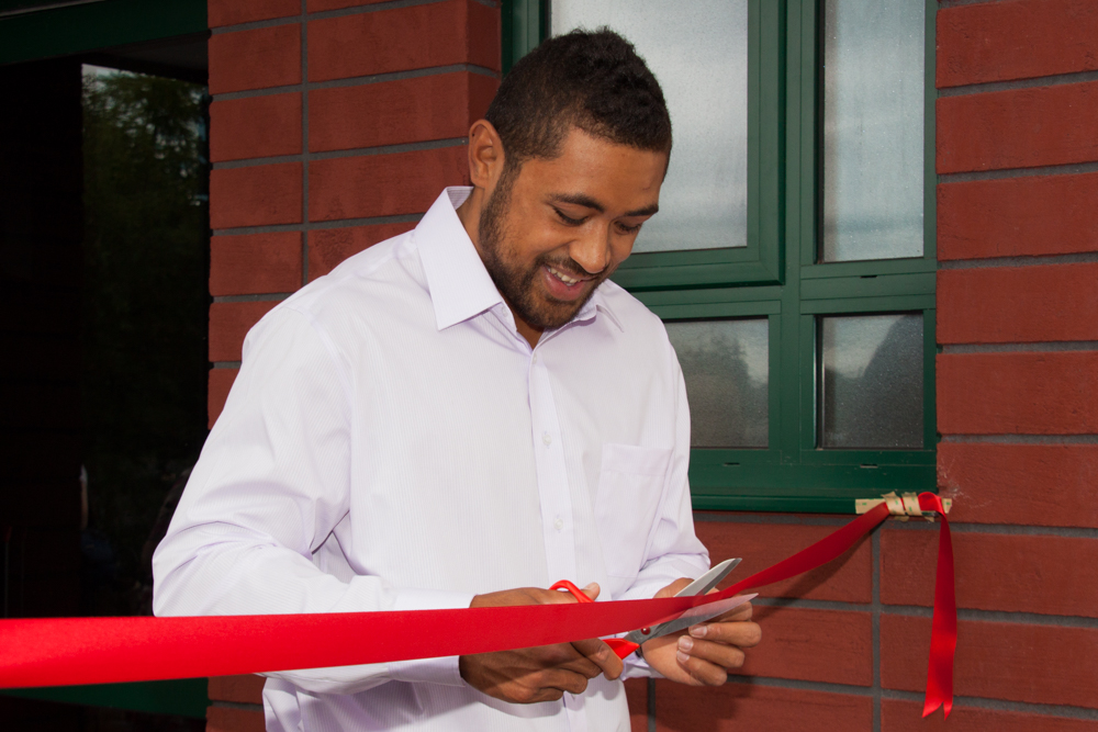Toby cutting the ribbon at the Official opening of the Centre